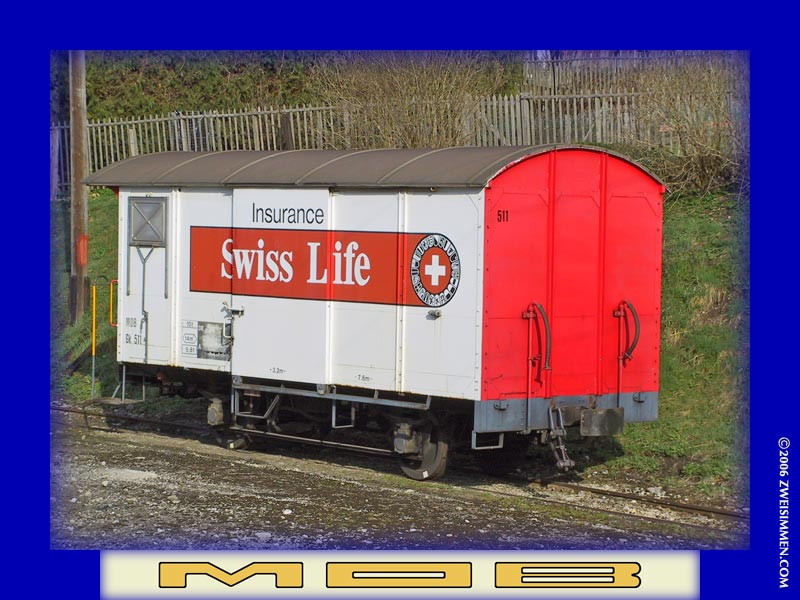 Gk511: MOB advertising boxcar 'Swiss Life' insurance, at _____, March 30, 2003, 0942