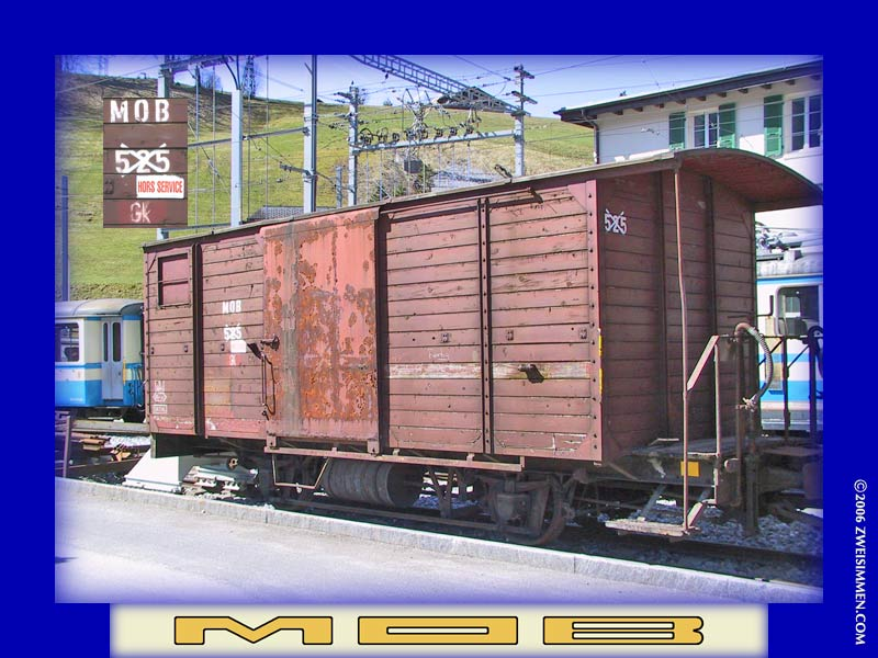 Gk525: MOB boxcar, out of service, at Zweisimmen, April 13, 2003, 1135