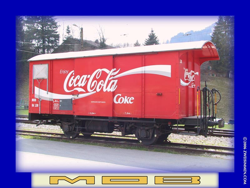 Gk530: MOB advertising boxcar 'Coca Cola', at Gstaad, April 17, 2003, 1438