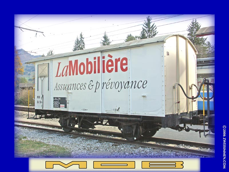 Gk514: MOB advertising boxcar 'La Mobilière, LH & rear, at Zweisimmen, October 21, 2005