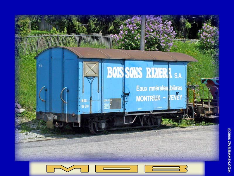 Gk518: MOB advertising boxcar 'Boissons Riviera', RH & rear, location unknown but near Les Avants, October 19, 2002