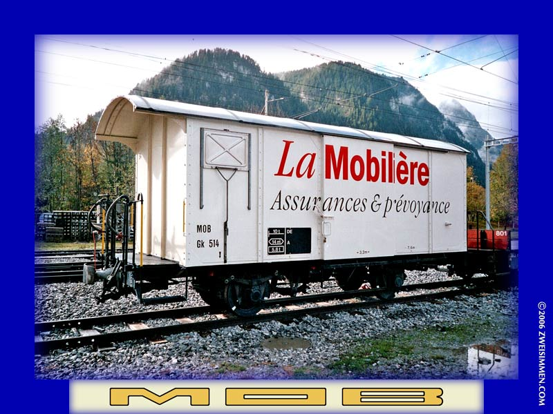 Gk514: MOB advertising boxcar 'La Mobilière, LH & front, at Zweisimmen, October 21, 2005